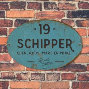 Naambord-Schipper-vintage-koenmeloen-voordeur-blauw-zwart-muur