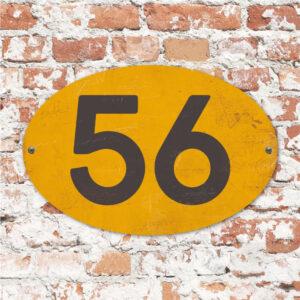 Koenmeloen-Huisnummer-bord-ovaal-geel-zwart